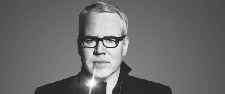 Bret Easton Ellis in black and white with iPhone flash