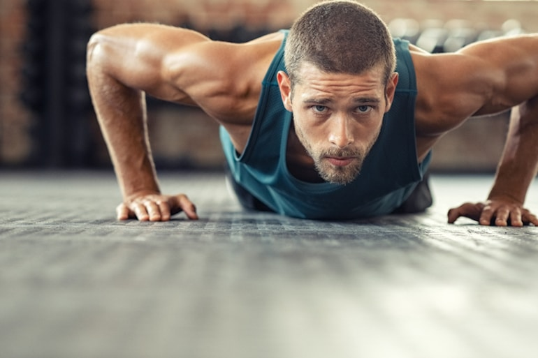 Man following a plant-based diet still building muscle with pushups