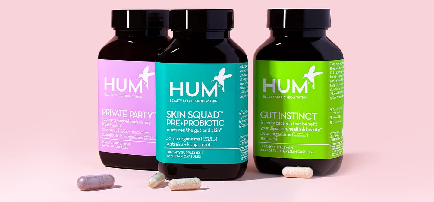 HUM Nutrition probiotics Private Party, Skin Squad, and Gut Instinct on pink background