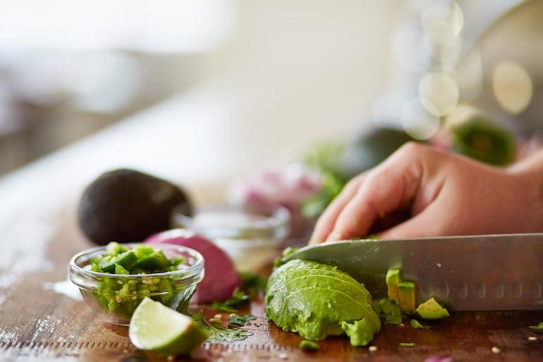 Cutting an avocado to be frozen