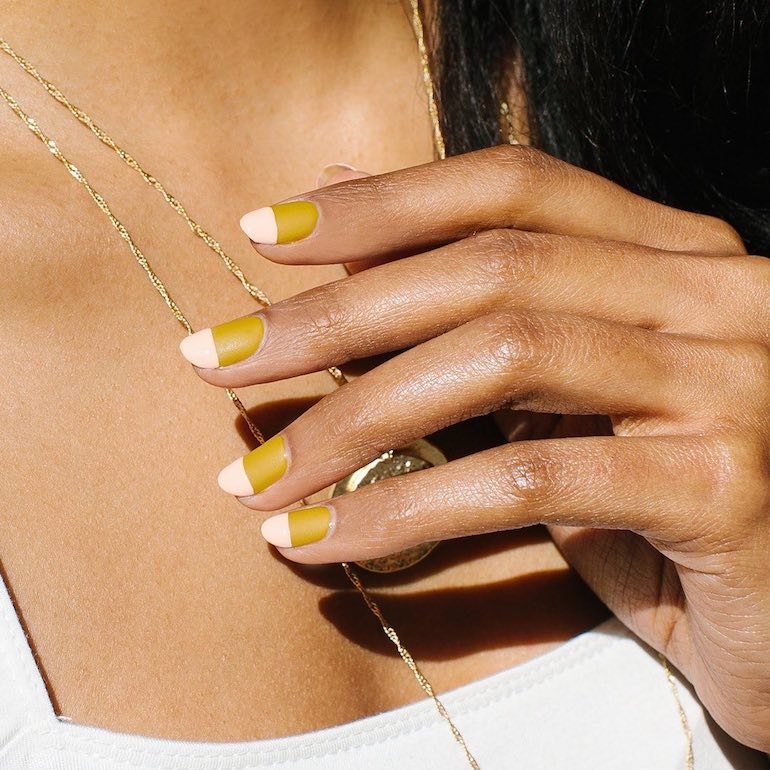 Woman with two-toned gel manicure
