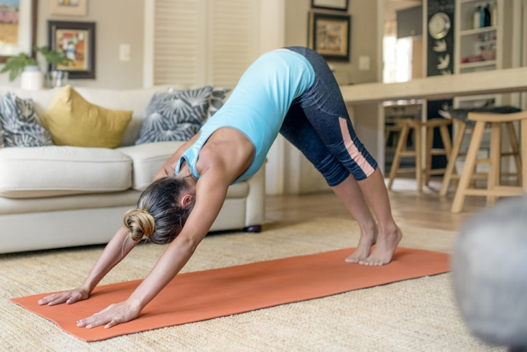How to warm up before a workout - do downward dog to stretch the back of your legs