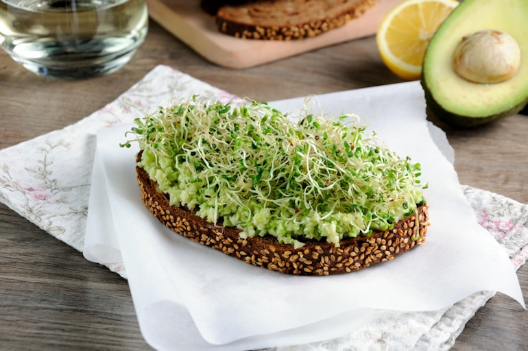 Avocado toast on Ezekiel bread with sprouts, a healthy breakfast idea for weight loss