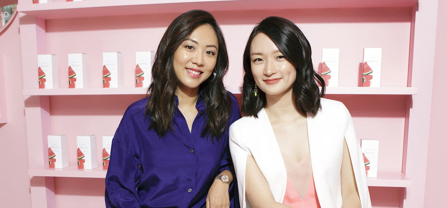 Glow Recipe funders Sarah Lee and Christine Chang in front of pink K-beauty background
