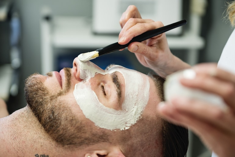 Man with beard getting a facial - more advanced step for skincare for men