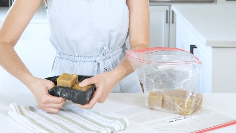Placing soup cubes into a frozen bag as the final step for the best way to freeze soup