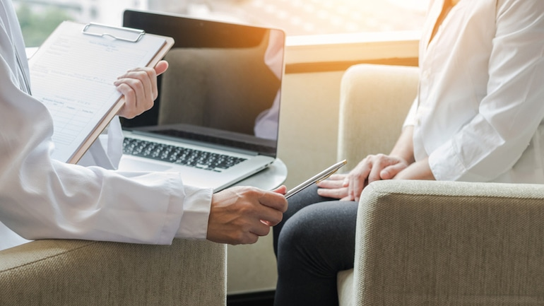 Woman consulting her doctor to see if vitex can help with fertility