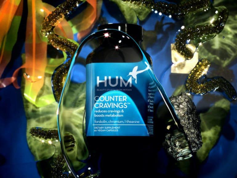 HUM Nutrition Counter Cravings supplement underwater amidst botanicals