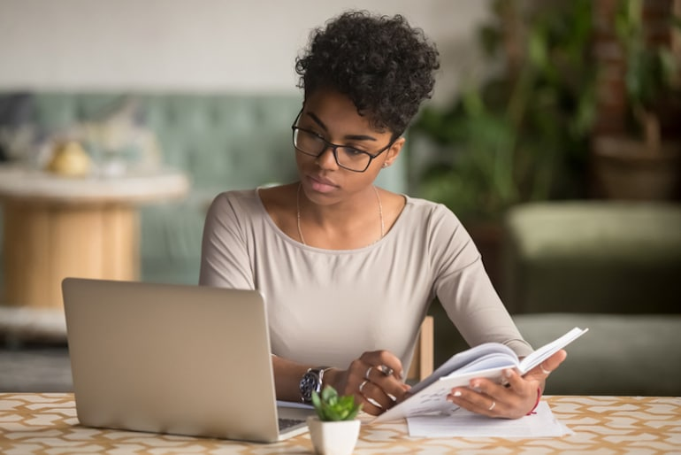 Woman focused at work at home office, busting the intermittent fasting myth that fasting saps energy and focus