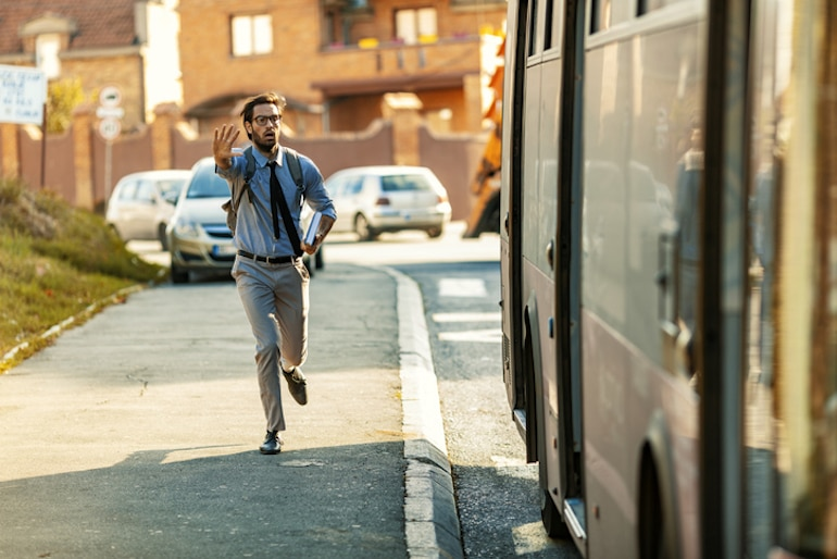 Man chasing a bus, with his cortisol levels spiked due to stress