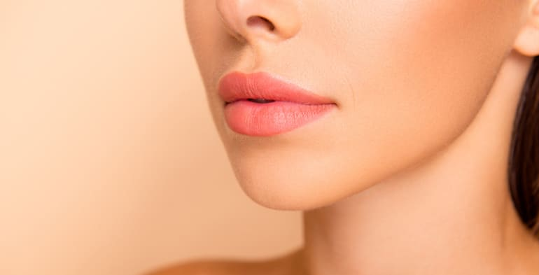 Profile view of woman with sculpted cheekbones from contouring with self-tanner