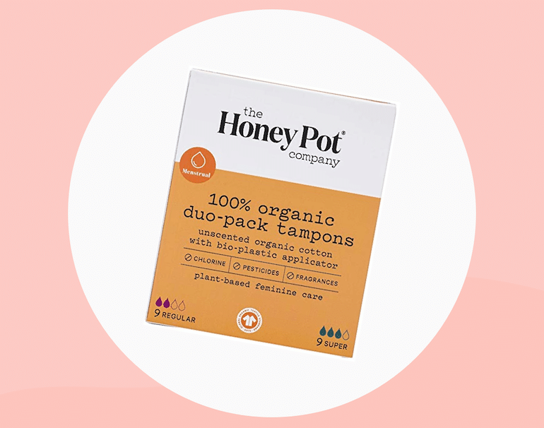 The Honey Pot Co organic tampons - a pack on a pink background
