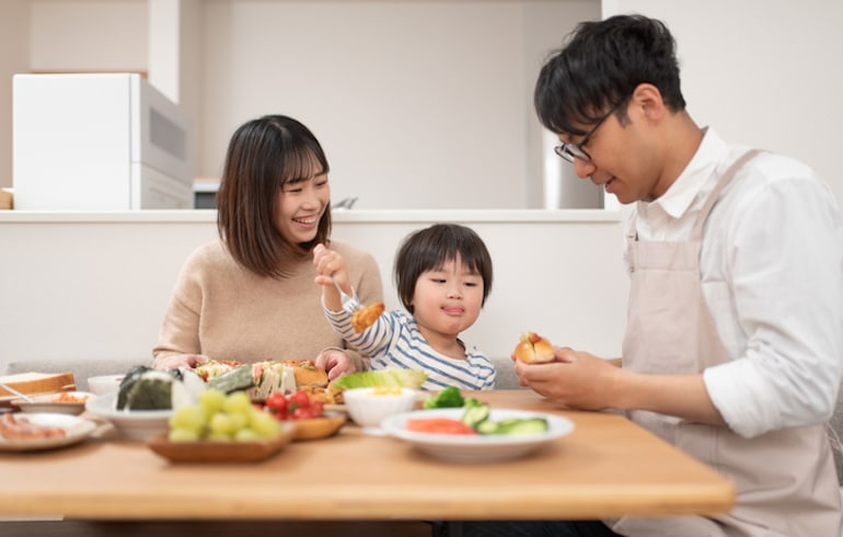 Asian family eating lunch at home that's unique to their ancestry and bio-individuality