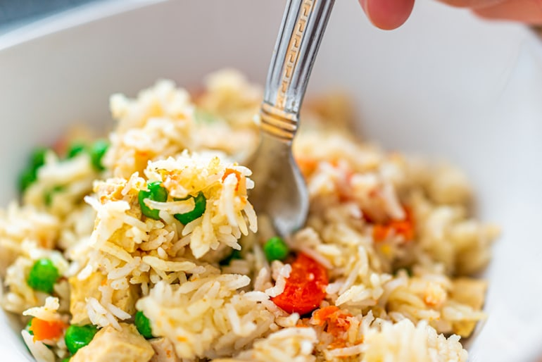 Digging into a balanced meal with rice for complex carbs, and veggies for color