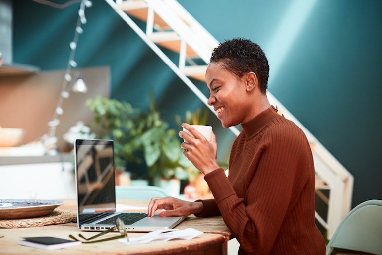 Woman working at home office, happy to finally achieve inbox zero