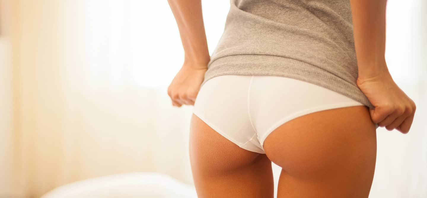 Woman in cheeky underwear showing her butt, illustrating the concept of the best ways to support butt care according to butt doctors