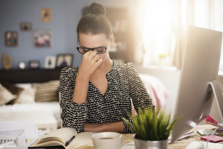 Woman stressed from her crowded inbox, in need to implement the inbox zero method for less stress and more productivity