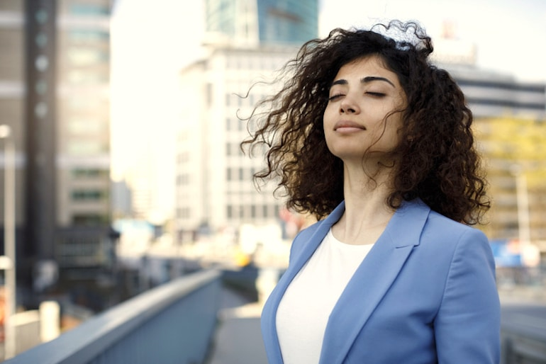 Woman taking a break from work to get air outside, which is often polluted with toxins