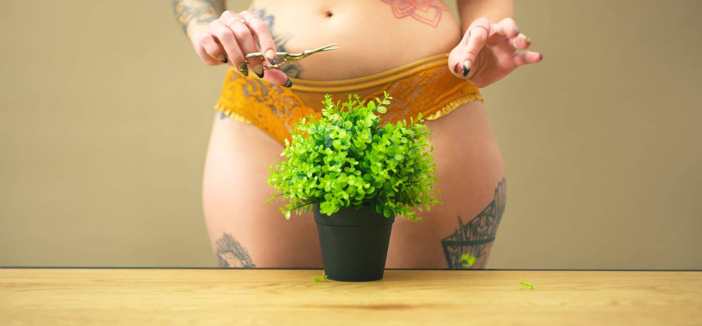 Woman in lingerie with plant in front of her vagina, illustrating embracing body hair for women