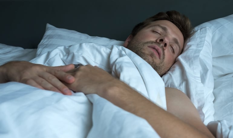 Man dreaming during REM sleep and having greater dream recall