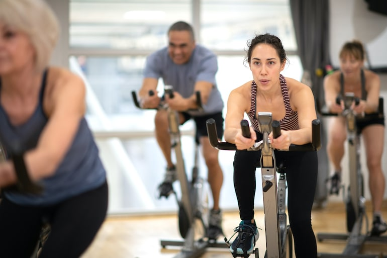 Group spinning class to illustrate cardio exercise concept for weight loss