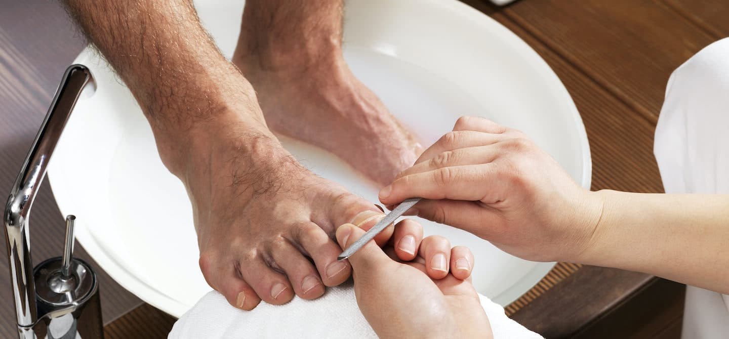 Man getting a pedicure, showing that men wearing nail polish is normal