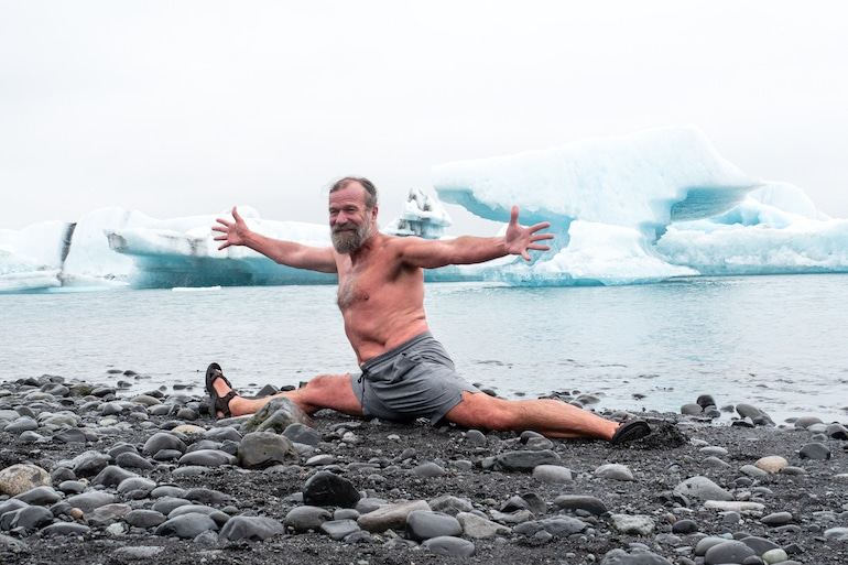 Wim Hof doing a split in Iceland to illustrate the proven scientific benefits of the Wim Hof Method and cold therapy