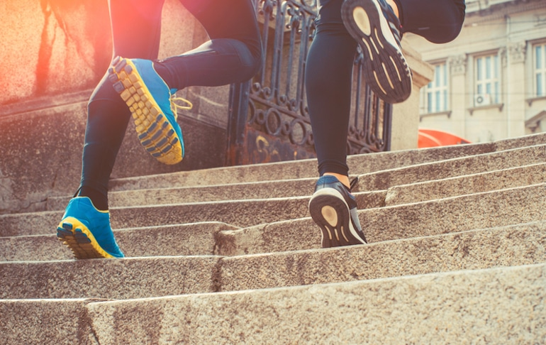 Couple running up stairs to demonstrate the effects of exercise on the immune system