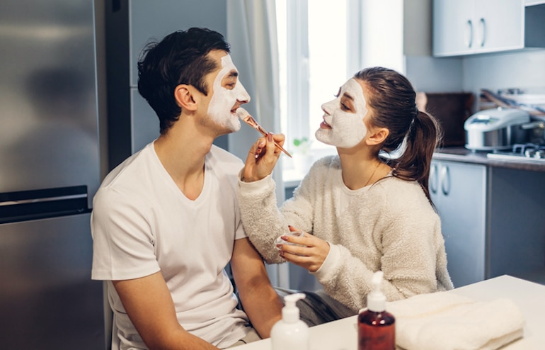 Couple applying homemade hydrating face masks to nourish winter dry skin
