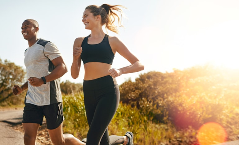 Man and woman jogging to stay fit and boost immunity naturally