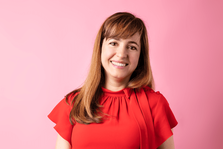 Sol de Janeiro Co-Founder Camila Pierotti in front of pink background