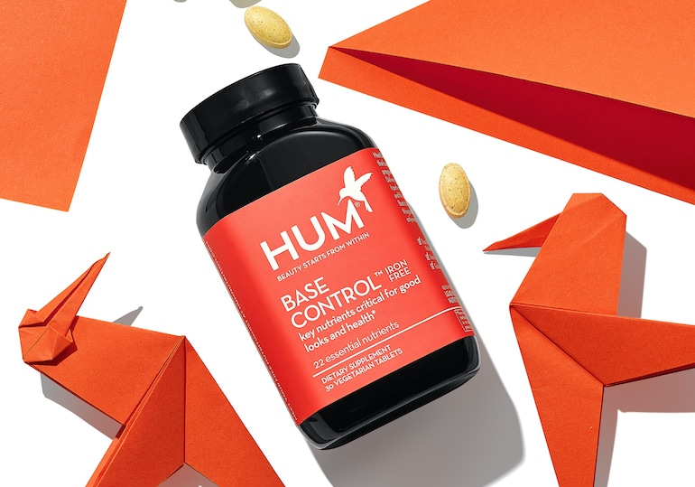 HUM Base Control multivitamin with red bird origami and vitamins for immunity