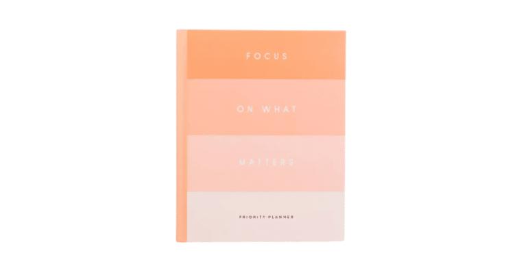 """Rachel Hollis """"Focus On What Matters"""" Planner in orange tones"""