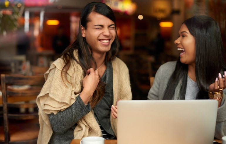 Friends laughing together at a cafe; count on those who value you