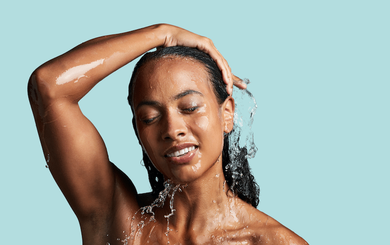 Woman washing her natural curly hair
