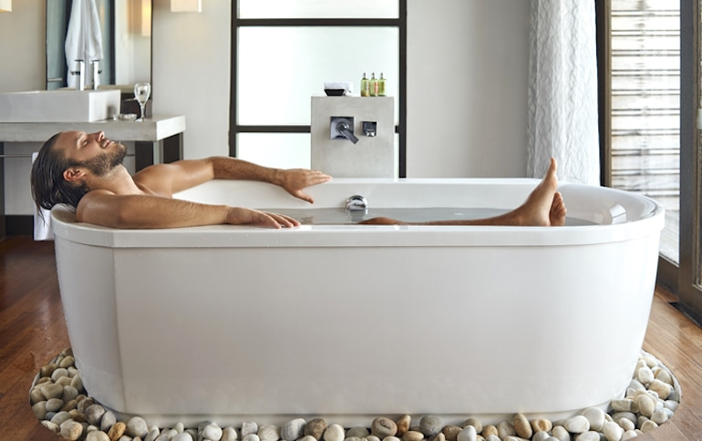 man taking a bath to relax and disconnect from stressors