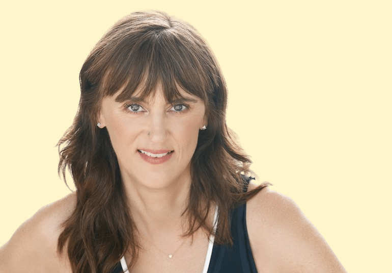 Headshot of Jen Sincero, author of Badass Habits and You Are a Badass, on yellow background