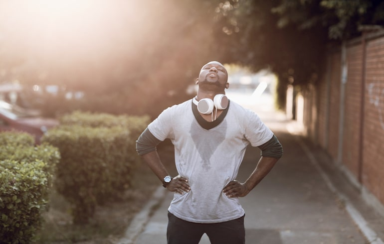 Man sweaty from a workout; high-intensity workouts can raise cortisol and stress