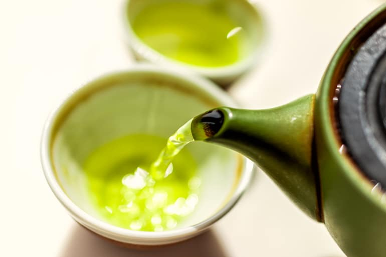 Pouring green tea because it benefits the skin