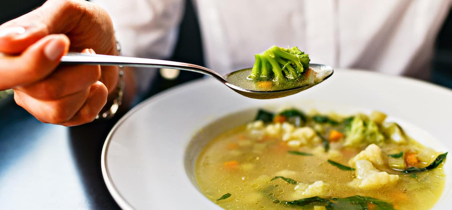 Eating soup with cruciferous vegetables as example of foods that are good for liver