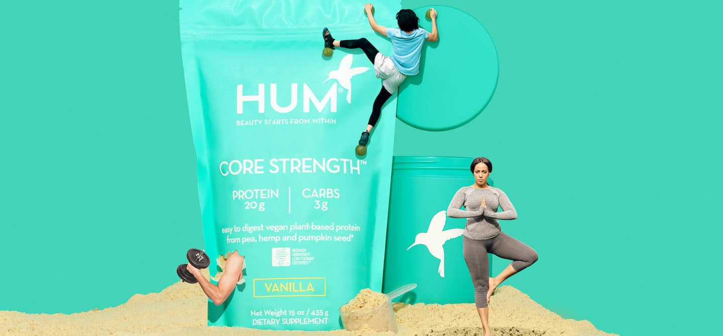 HUM Core Strength vegan protein powder in a fitness creative concept