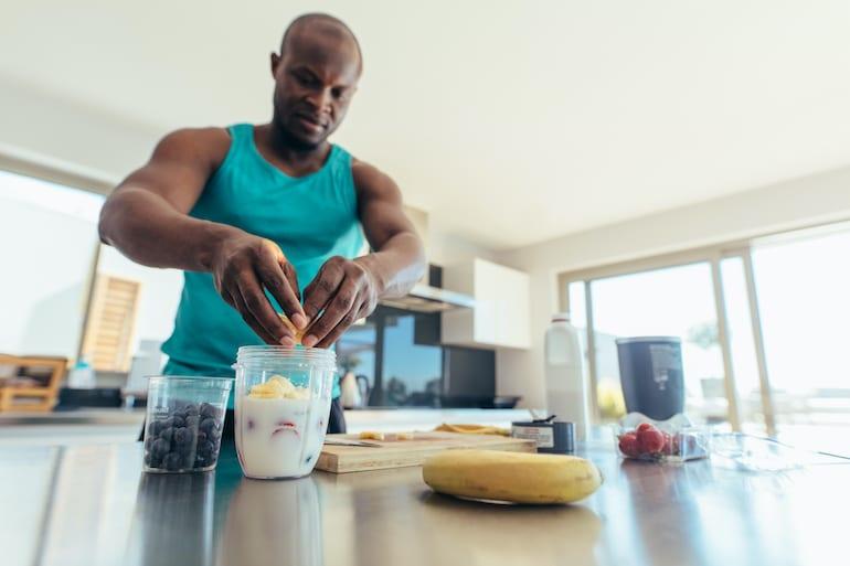 Man preparing smoothie as muscle repair food
