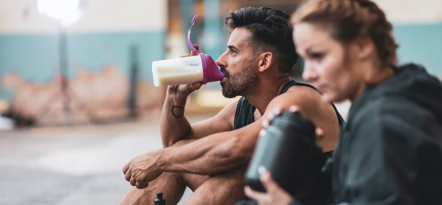 Man drinking protein shake after workout