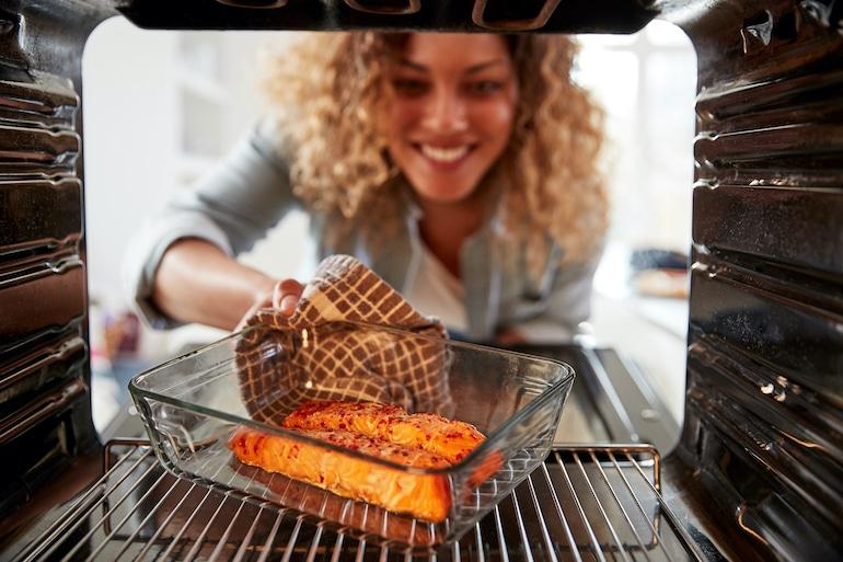 Woman eating salmon as a detoxification food