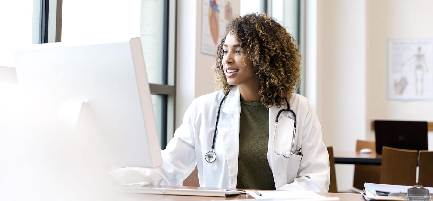 Healthy doctor on the computer; concept for how doctors boost their immunity to stay healthy