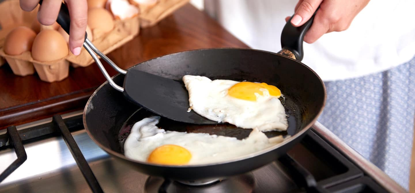 Immunologist cooking sunny side up eggs for breakfast to maintain immune health