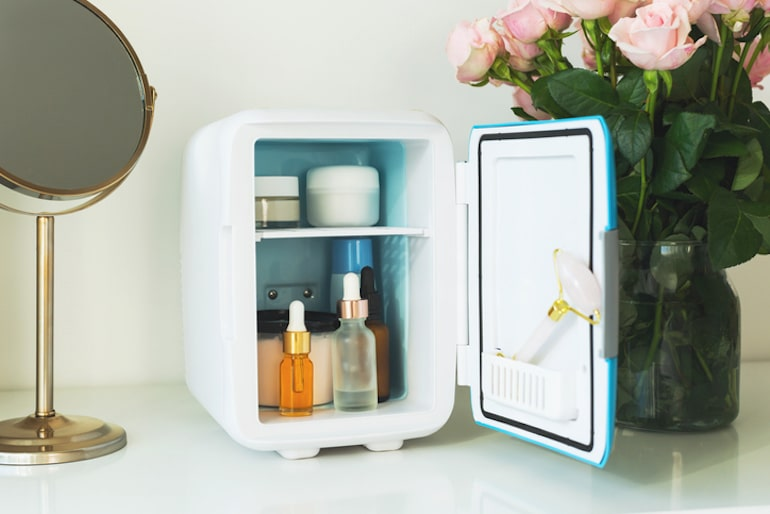 Makeup and other face products in a skincare fridge to prolong its shelf life