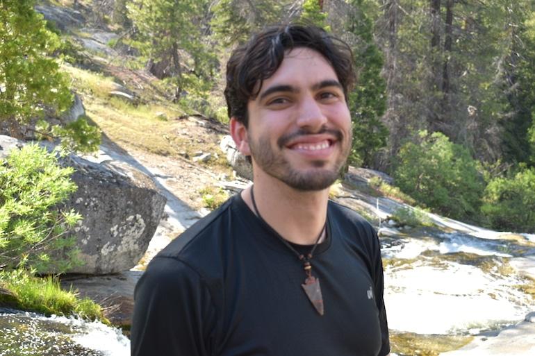 Manuel Miller, a HUM Diversify Dietetics Grant Recipient, outdoors smiling