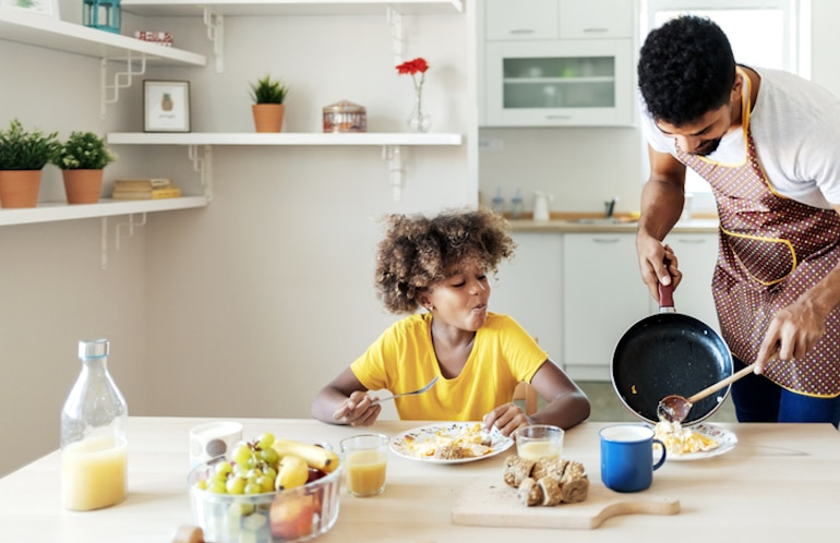 Father serving daughter the healthiest, best eggs for breakfast