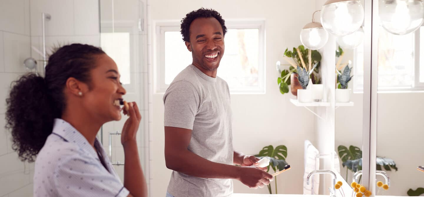 Couple brushing their teeth to prevent stains and yelllowing